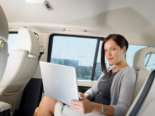 Executive businesswoman work laptop car backseat - ace limousines in chicago
